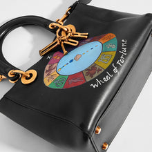 Load image into Gallery viewer, Top down detail of DIOR Vintage Lady Dior Wheel of Fortune Bag in Black leather