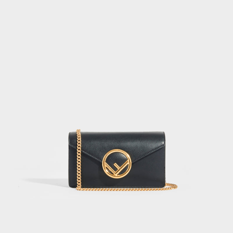 FENDI Belt Bag with Gold Logo Hardware in black leather and gold shoulder chain strap
