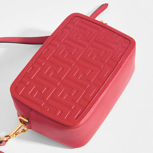 Close up of the FENDI Mini Camera Case Crossbody Bag in Red leather