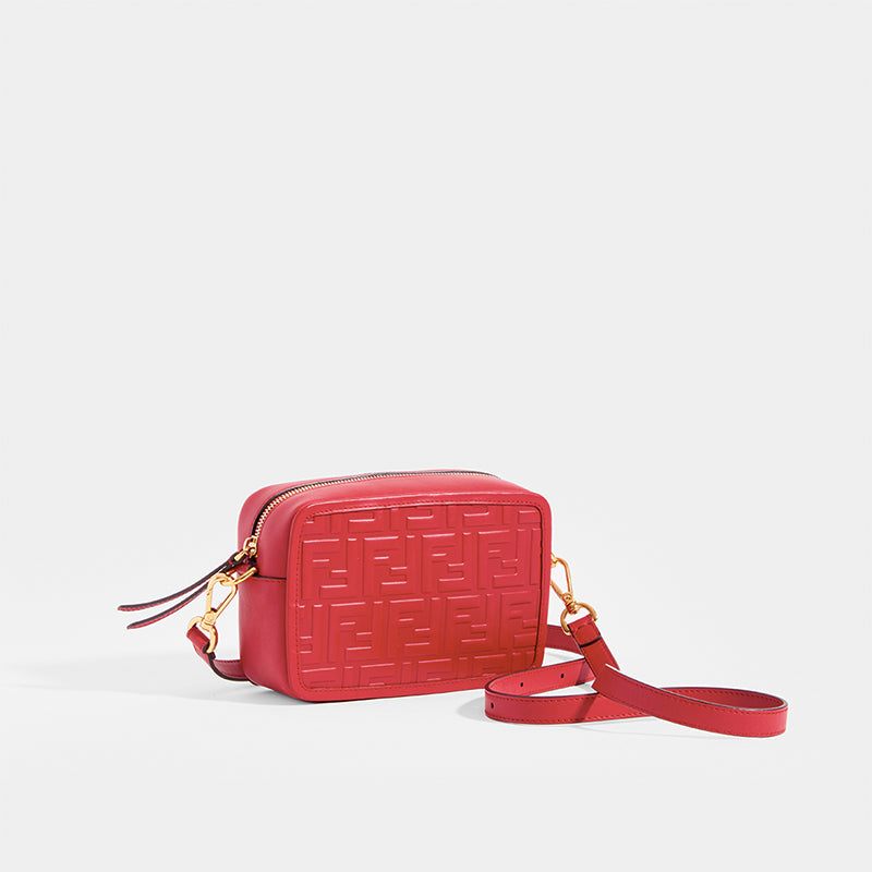 Side view of the FENDI Mini Camera Case Crossbody Bag with cross body strap