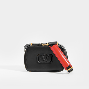 VALENTINO VSLING Small Leather Camera Bag with black shoulder strap and red strap detail