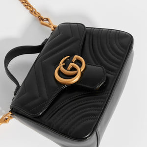 Top of GUCCI Mini GG Marmont Top Handle Bag in Quilted Black Leather