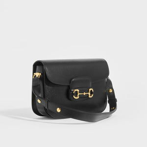 Side view of GUCCI 1955 Horsebit Shoulder Bag in Black Leather with adjustable strap