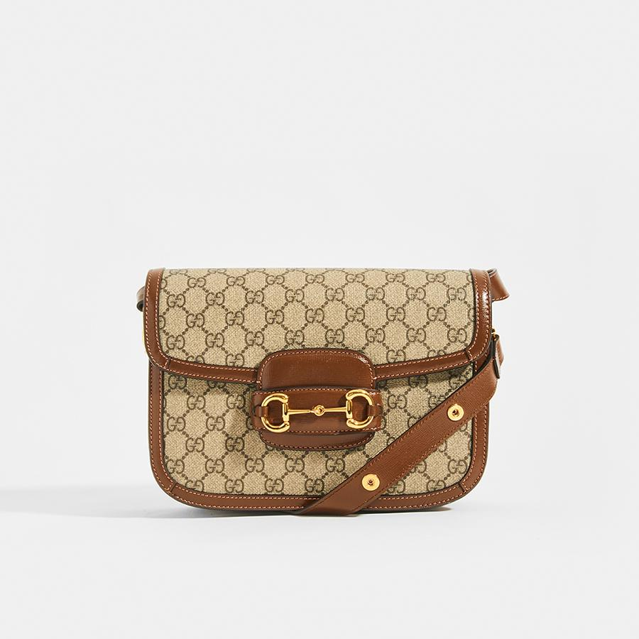 The GUCCI 1955 Horsebit Shoulder Bag in Canvas with Brown Leather Trim With Gold 'Horsebit' Hardware and Adjustable strap