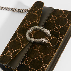 Clasp detail of GUCCI Dionysus Velvet GG Handbag in Dark Green