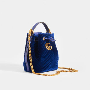 GUCCI GG Marmont Bucket Bag in Dark Blue Velvet with gold chain strap and top handle
