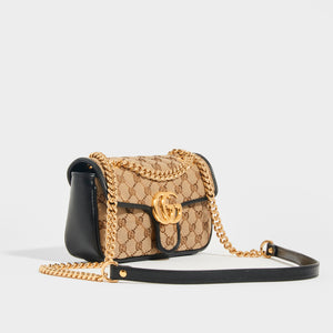 Side view of the GUCCI GG Marmont Mini Shoulder Bag in Original GG Canvas with gold metal chain and leather shoulder strap