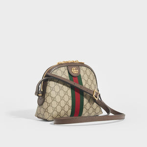 Side view of GUCCI Ophidia Coated Canvas Shoulder Bag with shoulder strap