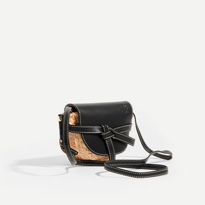 Side view of LOEWE Gate Crossbody Mini in Black leather flap and strap with Raffia