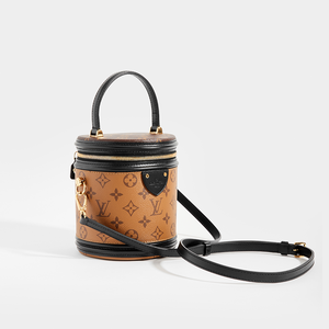 Side view of LOUIS VUITTON Monogram Reverse Canvas Cannes Bag with strap