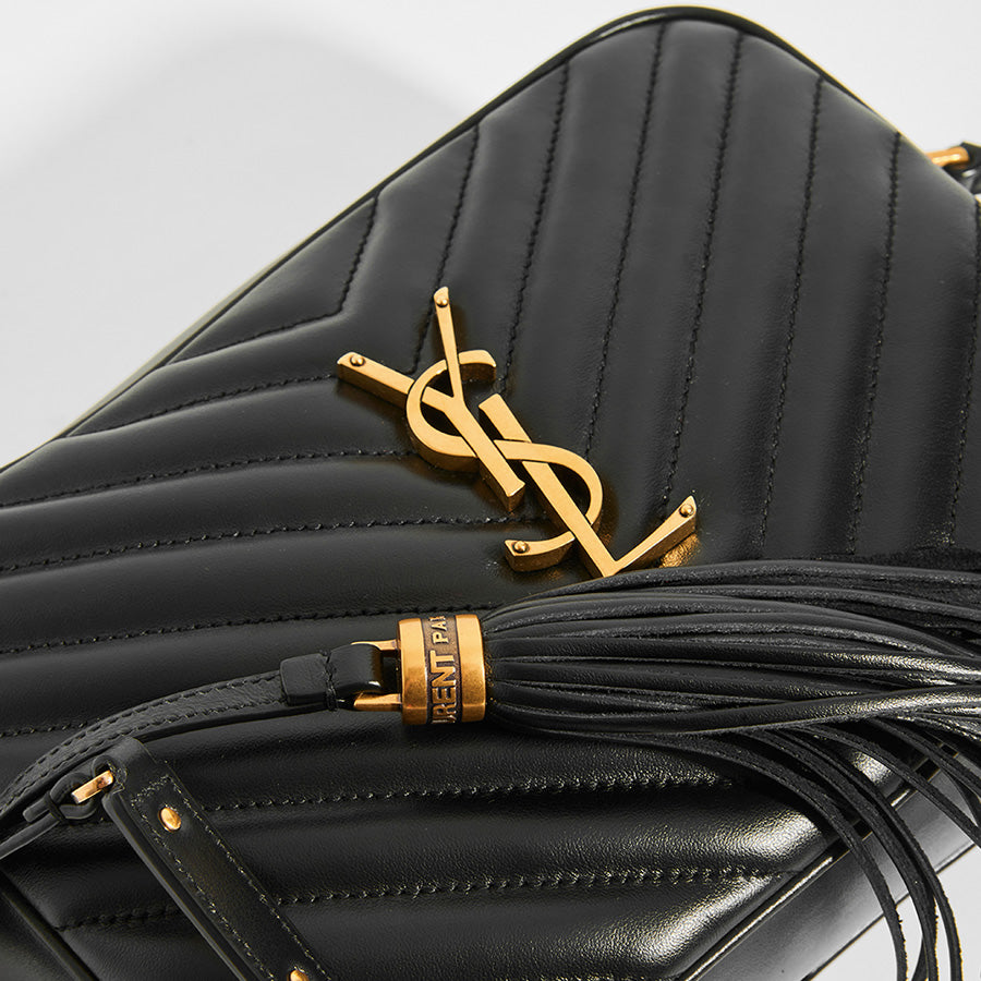 Gold Hardware & Leather Tassel Detail on SAINT LAURENT Lou Camera Bag in Black Matelassé Leather