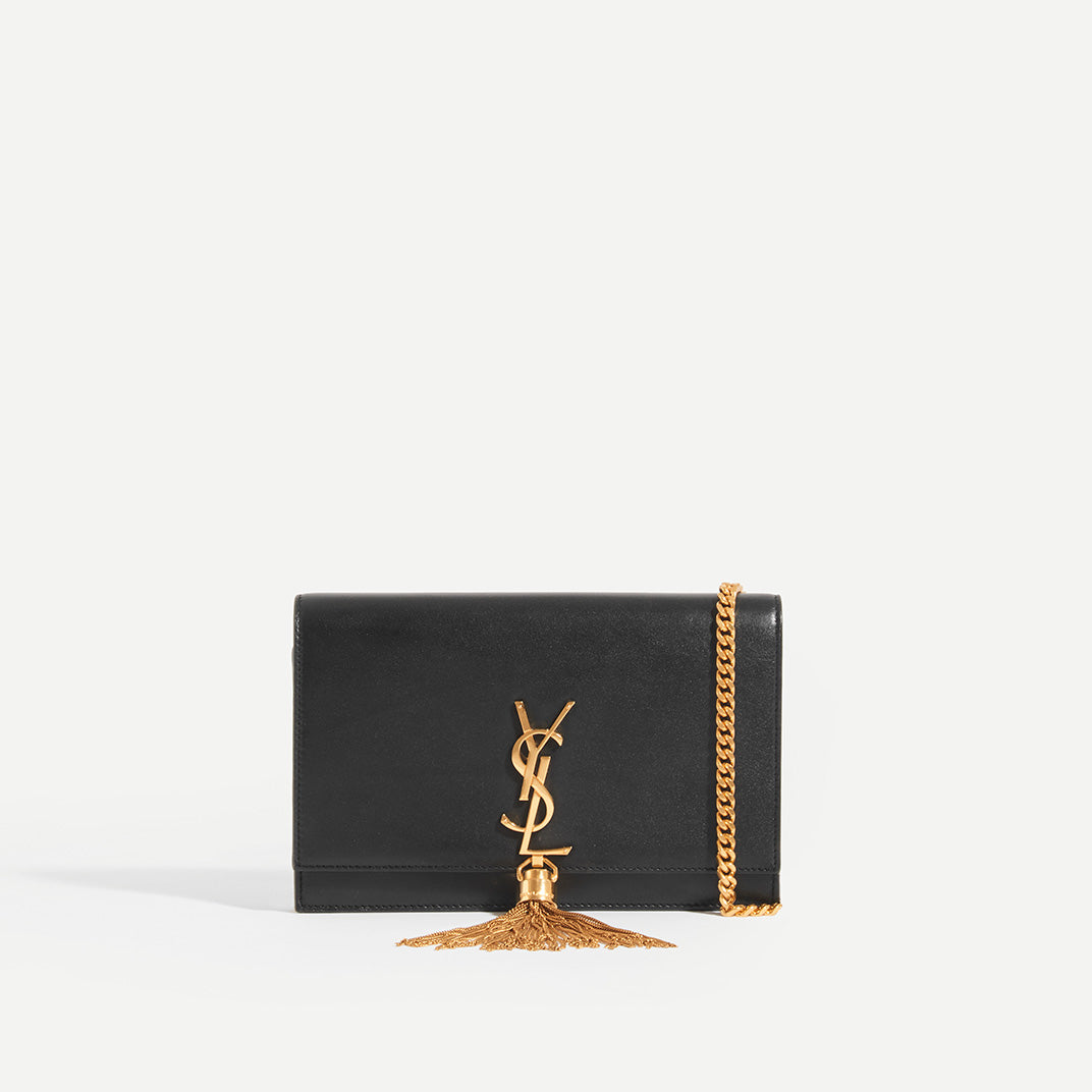 SAINT LAURENT Kate Wallet in Black Leather with Gold Metal Strap, Gold YSL Hardware and Gold Tassel
