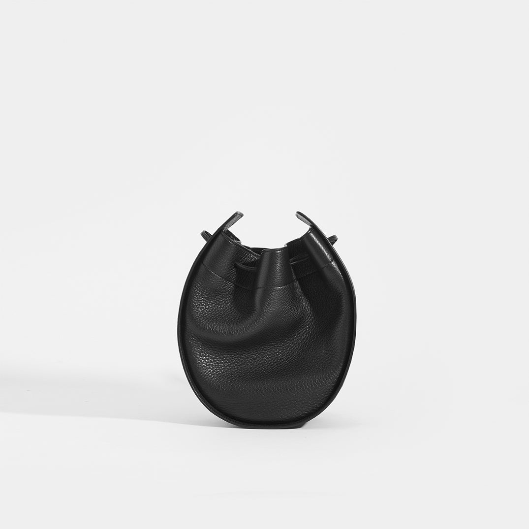 THE ROW Round Drawstring Leather Crossbody in Black Front View