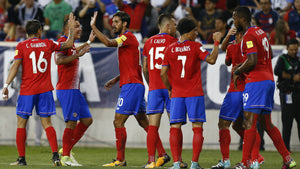 Costa Rica celebrating against the USA