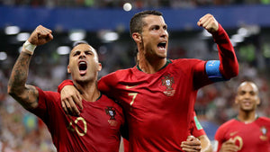 Portugal's Ricardo Quaresma and Cristiano Ronaldo celebrating at the 2018 World Cup