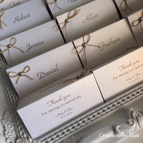 Printed Place cards with a thank you message on the rear. <br>embellished with a pearl bead and twine bow.