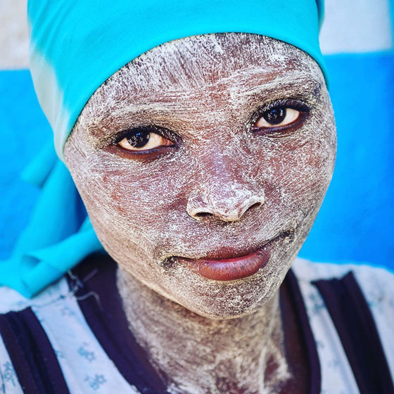 African colour | Woman with Muciro Face Mask, Ibo Island Mozambique