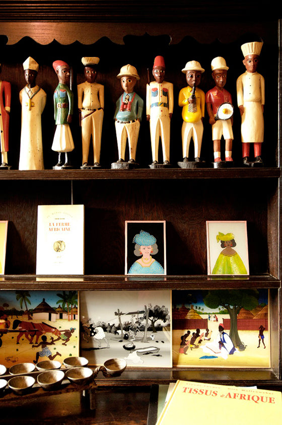 Quirky colonial men | A beautiful book shelf collection of West African Colon statues