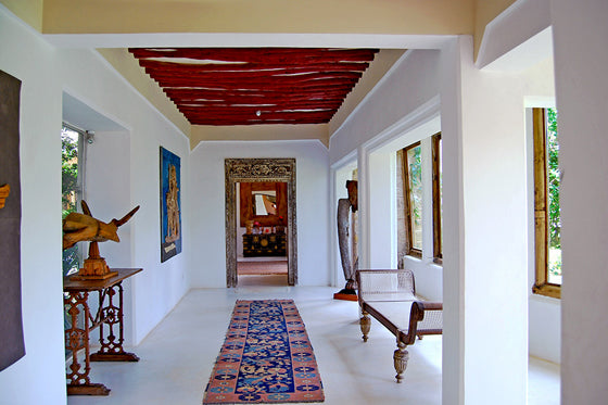 Colour pop | With artwork, hall runner and painted timber rafters at The Majlis Lamu, Kenya