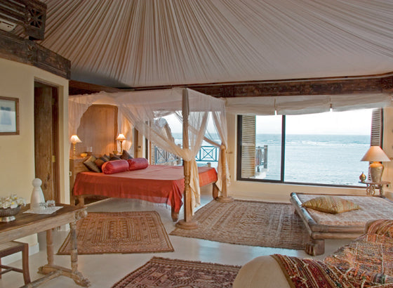 Four-poster beds | Coastal Arabian style at Alfajiri Villas, Kenya
