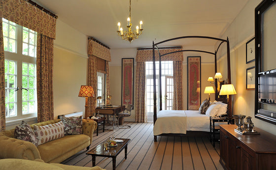 Four-poster beds | Colonial grace of the grand Stable Suite at the Victoria Falls Hotel, Zimbabwe
