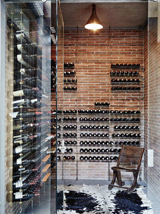 Klompie bricks | Industrial style wine cellar in a Groot Constantia residence, Cape Town South Africa