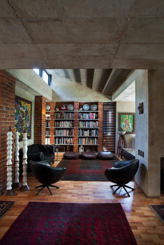 Library style | Brick and concrete modern industrial book shelves in a Pierneef [Pretoria] residence, South Africa