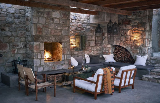 Safari Journal / Blog by Safari Fusion | Light a fire | Outdoor stone fireplace at Stone House, Hermanus / South Africa