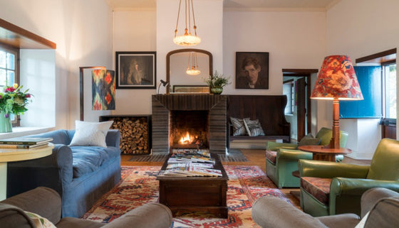 Safari Journal / Blog by Safari Fusion | Light a fire | Modern vintage living room at The Quarters Stellenbosch / South Africa