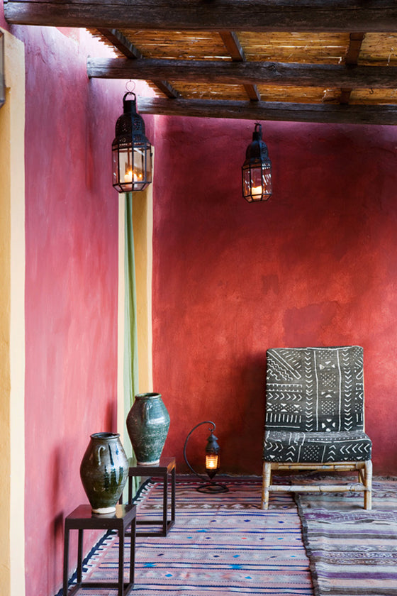 Mud cloth | Vintage Bogolan textile chair, Fabio House, Filicudi Island, Sicily Italy via photographer Adriano Bacchella