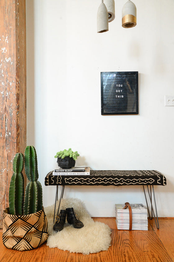 Mud cloth | Wire leg bench seat upholstered in black Bogolan fabric via Homepolish