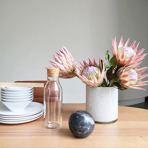 Pretty protea | Kitchen table styling featuring King Proteas via @stevecordony on Instagram