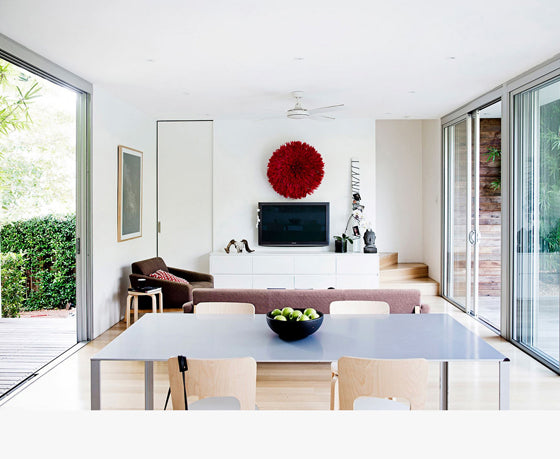 Safari Journal / Blog by Safari Fusion | Colour crush / red | A stylish Swiss inspired home in Sydney featuring one very beautiful Safari Fusion Red Bamileke Feather Headdress via Real Living