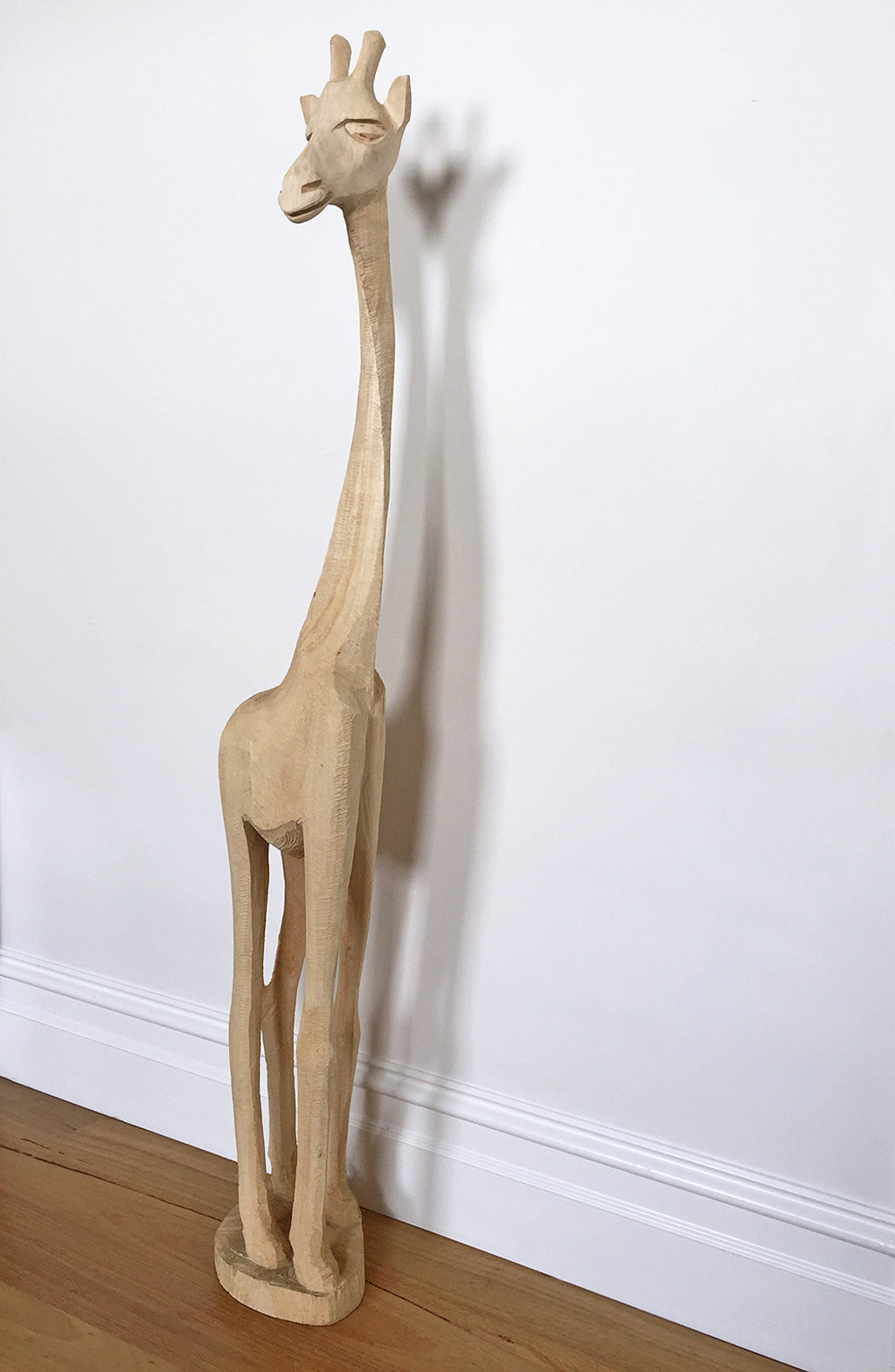 Animal instincts / giraffe | Swazi Giraffe, a chainsaw Jacaranda wood carving from Eswatini [Swaziland]