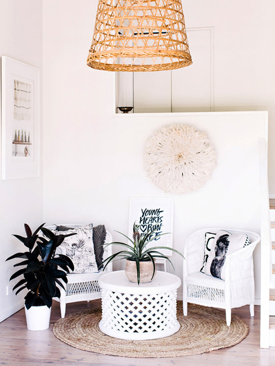 White on white | Lovely seating nook featuring a White Bamileke Feather Headdress [Juju hat] and a Bamileke Stool + Table