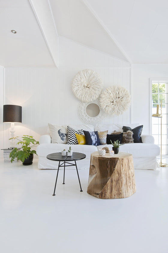 White on white | A fresh and light livingroom with two White Bamileke Feather Headdresses [Juju hats]