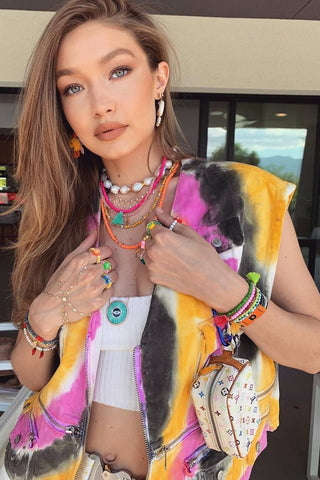 Gigi Hadid wearing a pearl and bead necklace stack