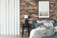 Interior bedroom wall with brick cladding