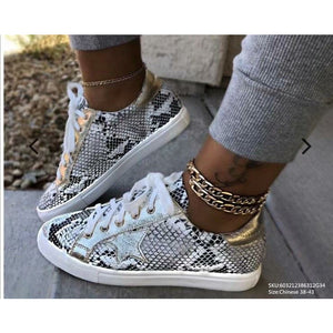 Snakeskin tennis shoes