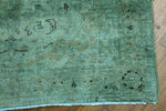 distressed teal rug