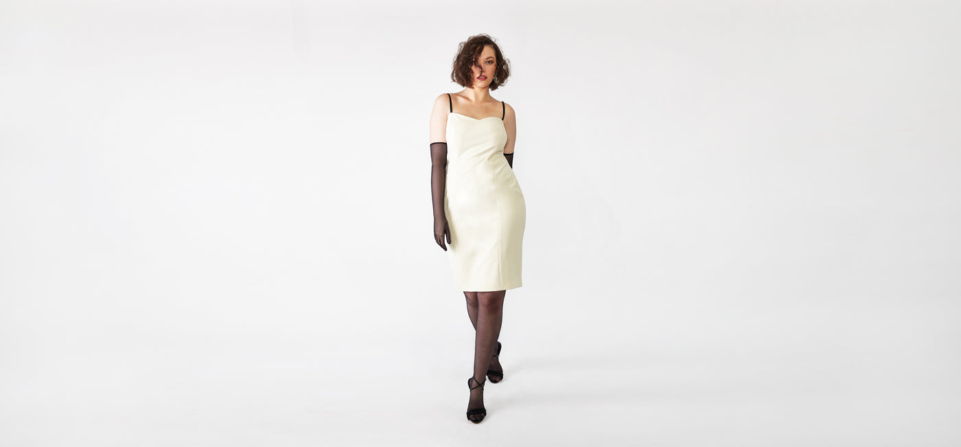 White tank dress with black straps and heart detail for plus-size