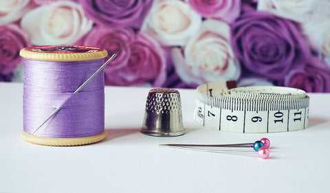 Sewing thread and needle and measuring tape