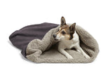 Dog snuggling inside Big Shrimpy Den Dog & Cat Bed - Plum