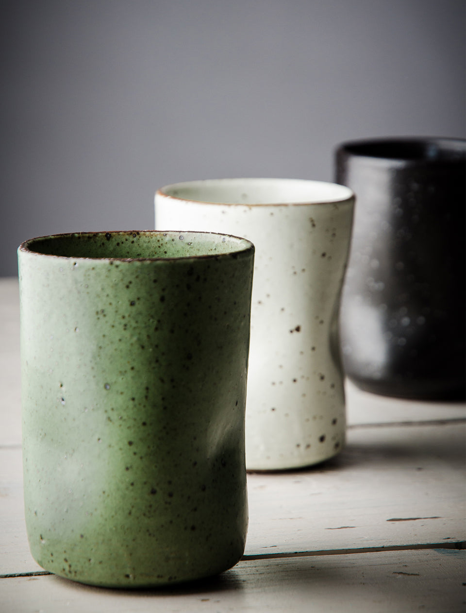 Cool handmade ceramic thumb shaped mugs.