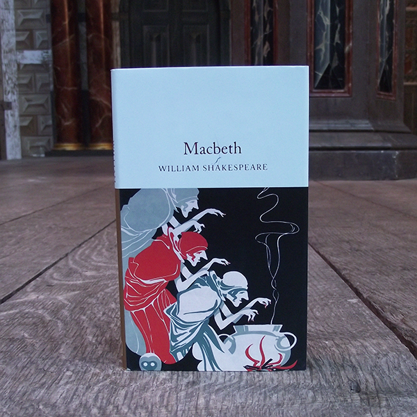 Pocket sized hardback Collector's Library edition of Shakespeare play, Macbeth. The upper part of the cover is pale blue with the play title in gold. The lower part of the cover shows an illustration of three witches crouched over a cauldron with flames beneath it.