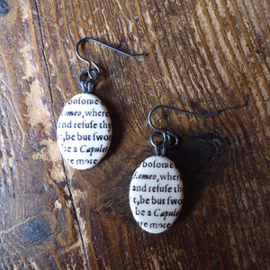 Oval ceramic earrings featuring a snippet from Juliet's balcony speech in Romeo and Juliet