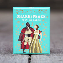 Box of Shakespeare playing cards. The box is turquoise with an illustration of Othello and Desdemona. Othello wears a white doublet and hose and a red cloak, Desdemona wears a gold dress. The couple is surrounded by gold, floral border