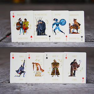 A selection of playing cards from a set of Shakespeare playing cards. Each card features an colourful illustration of a Shakespeare character.