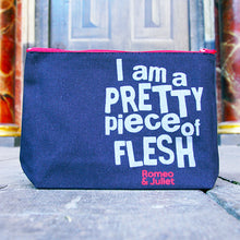 Black cotton bag with a gusset and a red zip. The bag is printed in a light grey with a quote from Shakespeare play, Romeo and Juliet (I am a pretty piece of flesh). The lettering is bold, with 'pretty' and 'flesh' in capitals Under the quote is the title of the play printed in red.