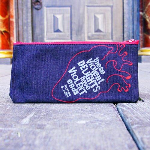 Black cotton pencil case with a red zip. The case is printed with the outline of an anatomical heart in red. Inside the heart is printed a quote from Shakespeare play, Romeo and Juliet (these violent delights have violent ends)